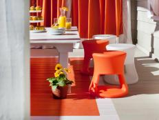 White and Orange Dining Area With Painted Rug