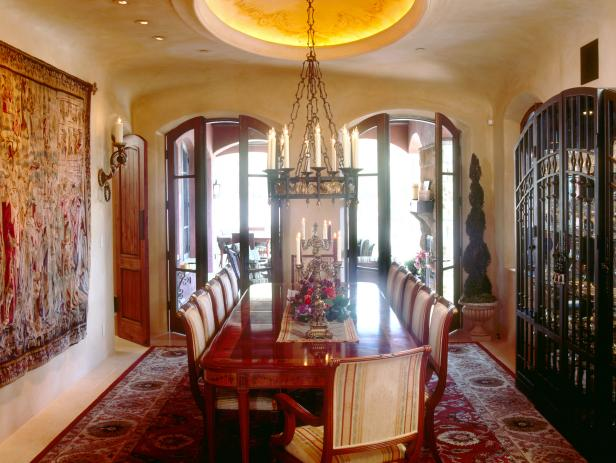 Neutral Mediterranean Style Dining Room With Wrought Iron Chandelier