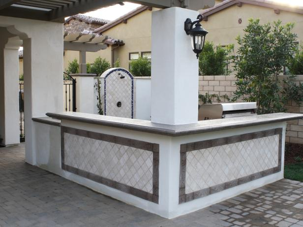 Outdoor Kitchen with L-Shaped Counter and Outdoor Shower