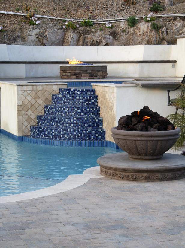 Pool With Blue Tile Stairs to Hot Tub and Stone Fire Pit
