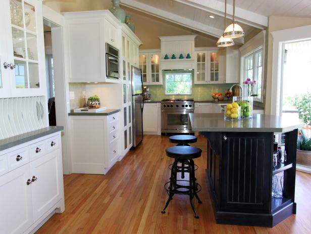 Neutral Kitchen With Vaulted Ceiling, Wood Floors and White Cabinets