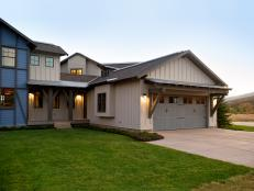 An integrated garage borrows design features from the modern rustic ranch home.