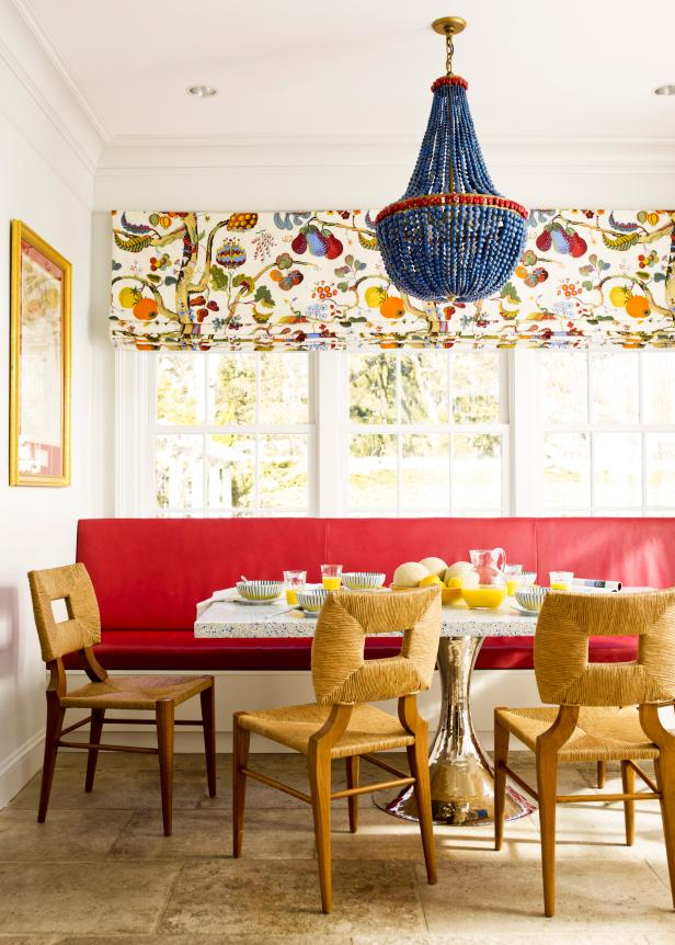 White Dining Room With Red Bench & Blue Beaded Chandelier