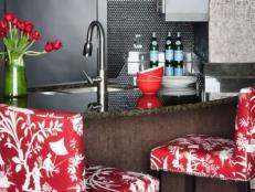 Contemporary Black Metallic Kitchen With Red and White Bar Chairs