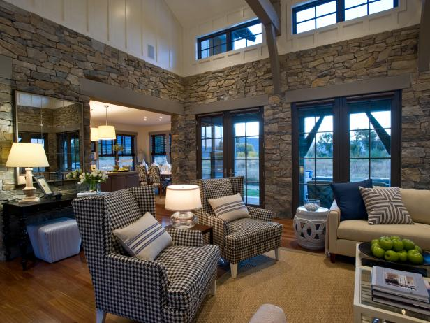 Great Room With Gray Stone Walls and Checkered Wingback Chairs