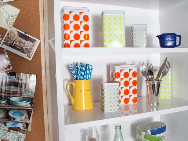 Colorful Canisters on White Kitchen Shelves