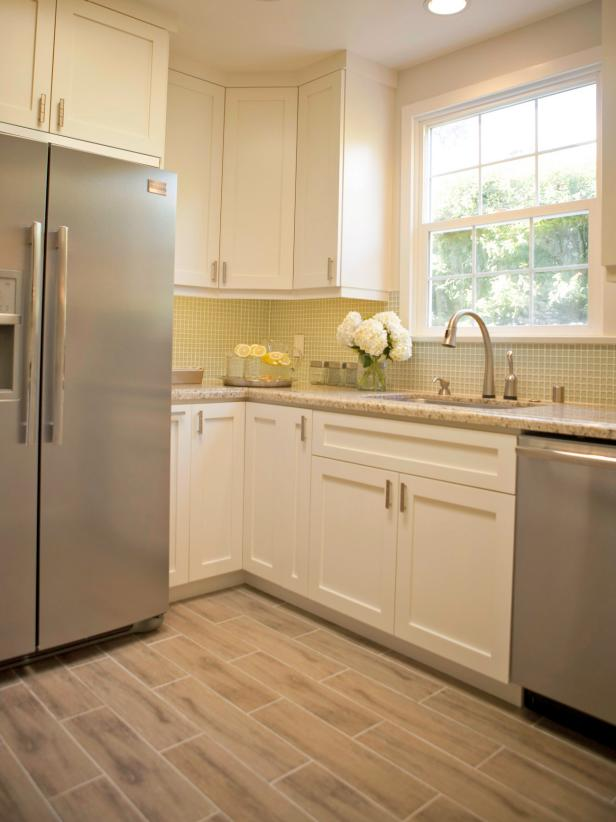 White Kitchen With Glass Tile Backsplash and Stainless Appliances