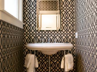 Black and White Powder Room With Graphic Wallpaper