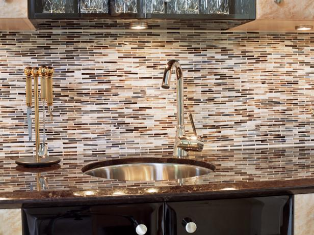 Brown, Gray and White Tile Backsplash With Metal Sink and Faucet