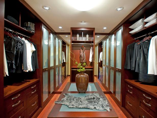 Long Walk-In Closet With Wood Storage Space and Recessed Lighting