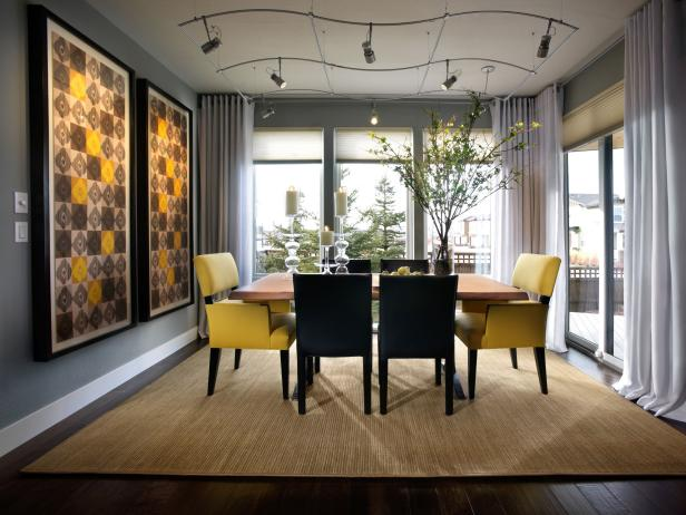 Gray Dining Room With Black and Yellow Dining Chairs and Colorful Art