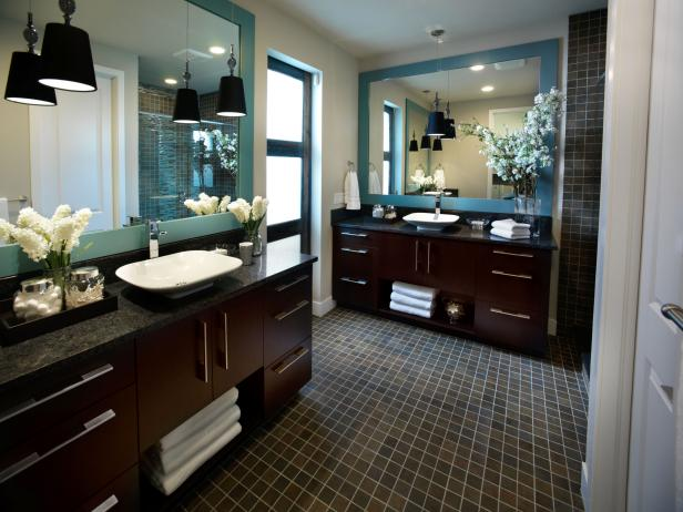 Bathroom With Contemporary Wood Vanities, Blue Mirrors and Tile Floor