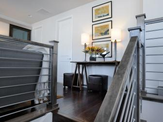 Wood Stairs With Iron Railing Lead to White Loft