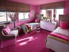 An oversized guest room, which overlooks the neighborhood's sledding hill, pops with a palette of hot pink and green.
