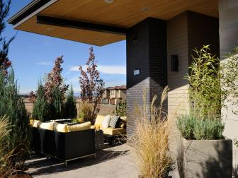 Contemporary Patio With Yellow-Orange Outdoor Seating Area