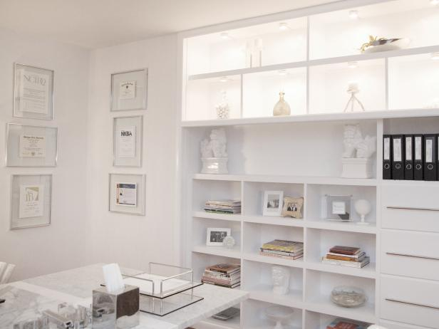 White Home Office With Built-In Shelving and Lighting