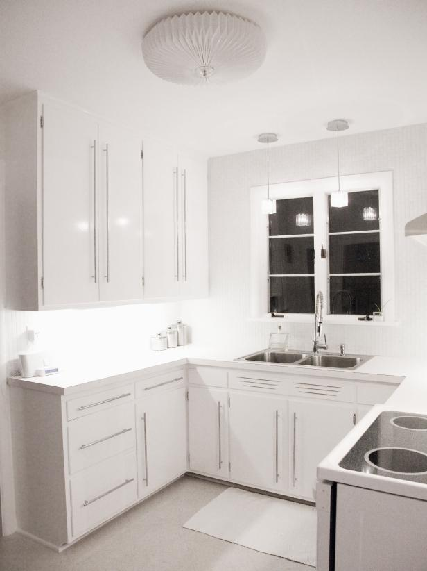 Contemporary White Kitchen with Storage and Silver Hardware