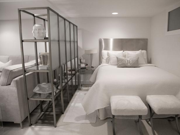 White Bedroom and Seating Space With Stainless Steel Accents