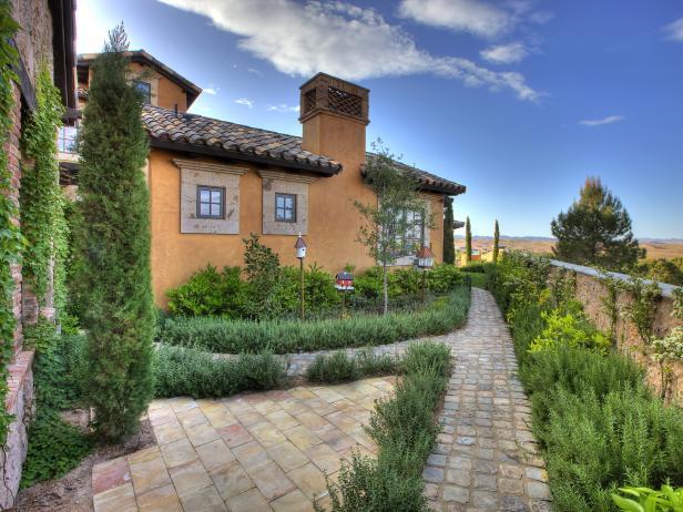 Stone and Evergreens Line Countryside Home Exterior