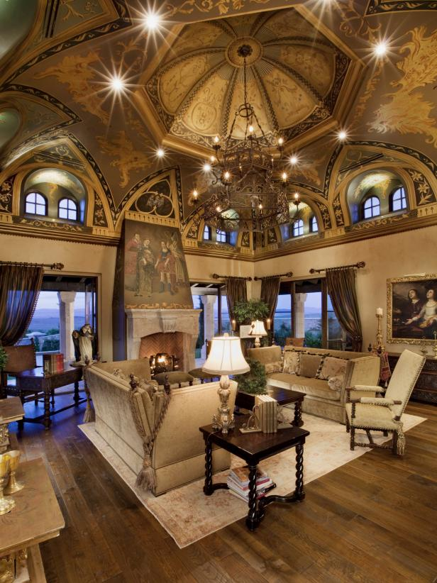 Living Room With Gothic Art Ceiling and Large Chandelier