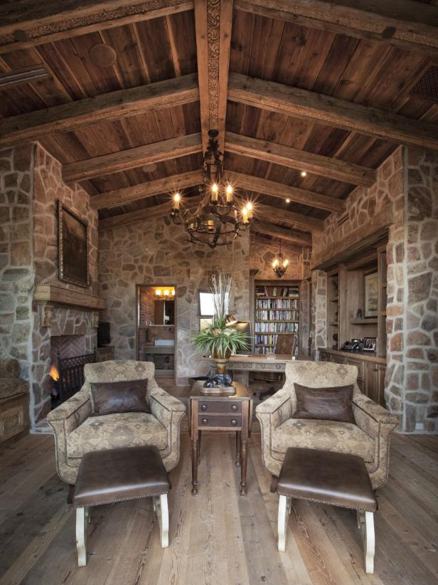 Stone Office With Upholstered Chairs, Wood Ceiling and Stone Walls