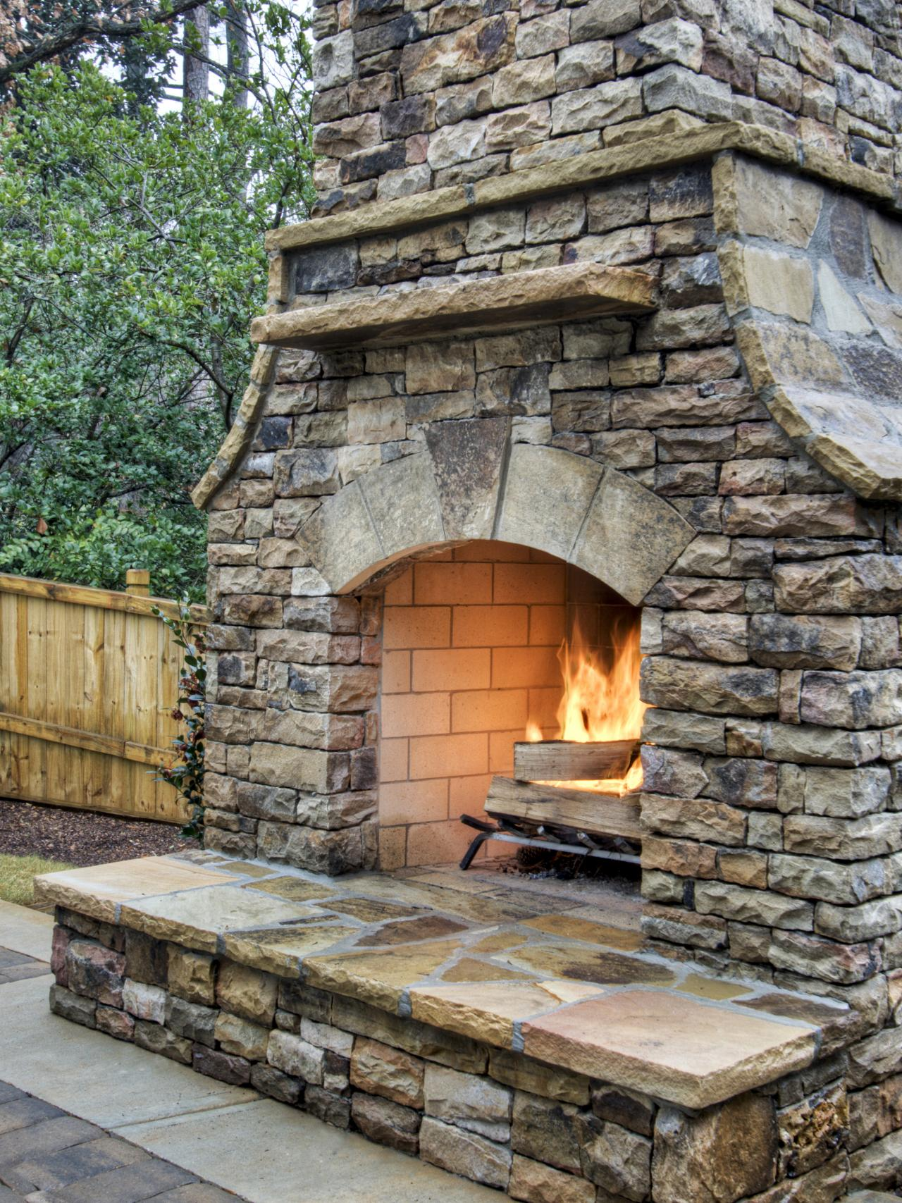 how to build an outdoor stacked stone fireplace hgtv