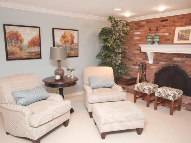 Blue Living Room With Brick Fireplace, Neutral Chairs and Blue Stools