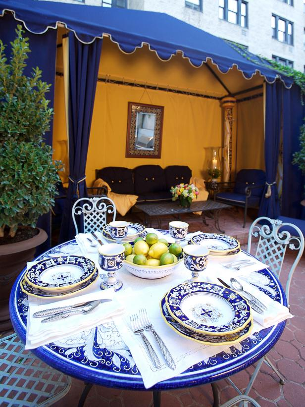 Outdoor Dining Area With Ceramic Table Setting and Medieval Tent