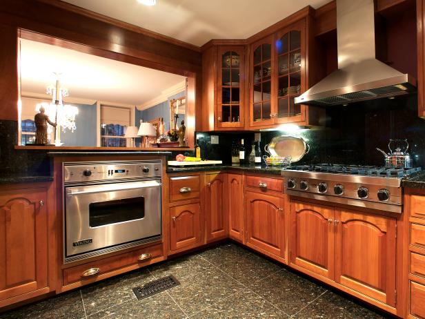 Traditional kitchen with warm wood cabinetry hgtv for Traditional kitchen appliances