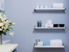 Contemporary Floating Shelves Line Blue Bathroom Wall