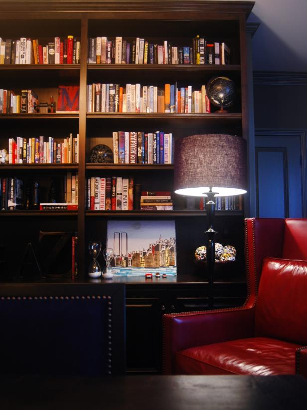 Wood Bookcase With Colorful Books and Red Leather Chair
