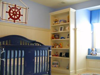 Nautical Nursery With Yellow Beadboard and Navy Crib