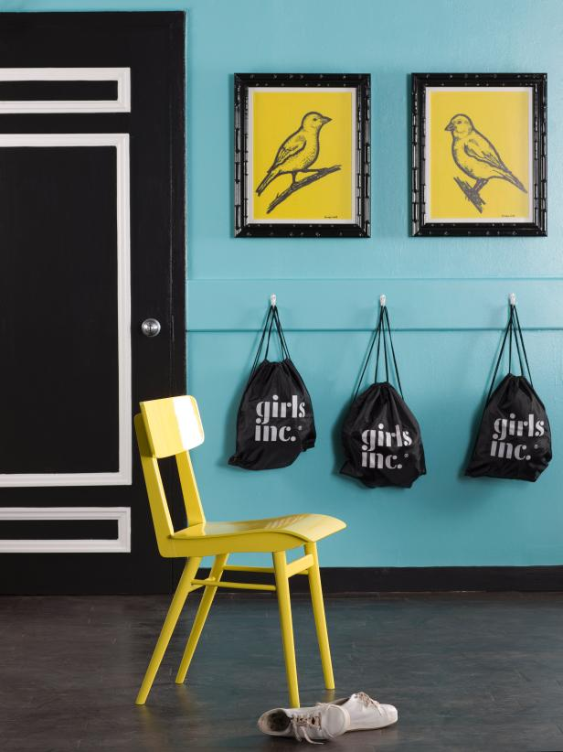 Modern Kids' Room With Coat Hooks and Bird Artwork