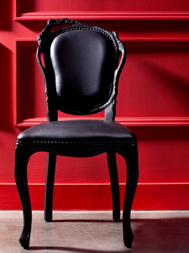 Red Wall and Black Chair