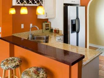 Orange Traditional Kitchen With Mounted Wine Rack