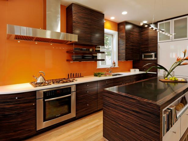 Stylish Orange Kitchen With Brown Cabinetry