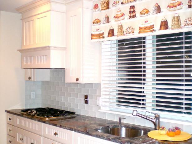 white kitchen with matte glass tile backsplash