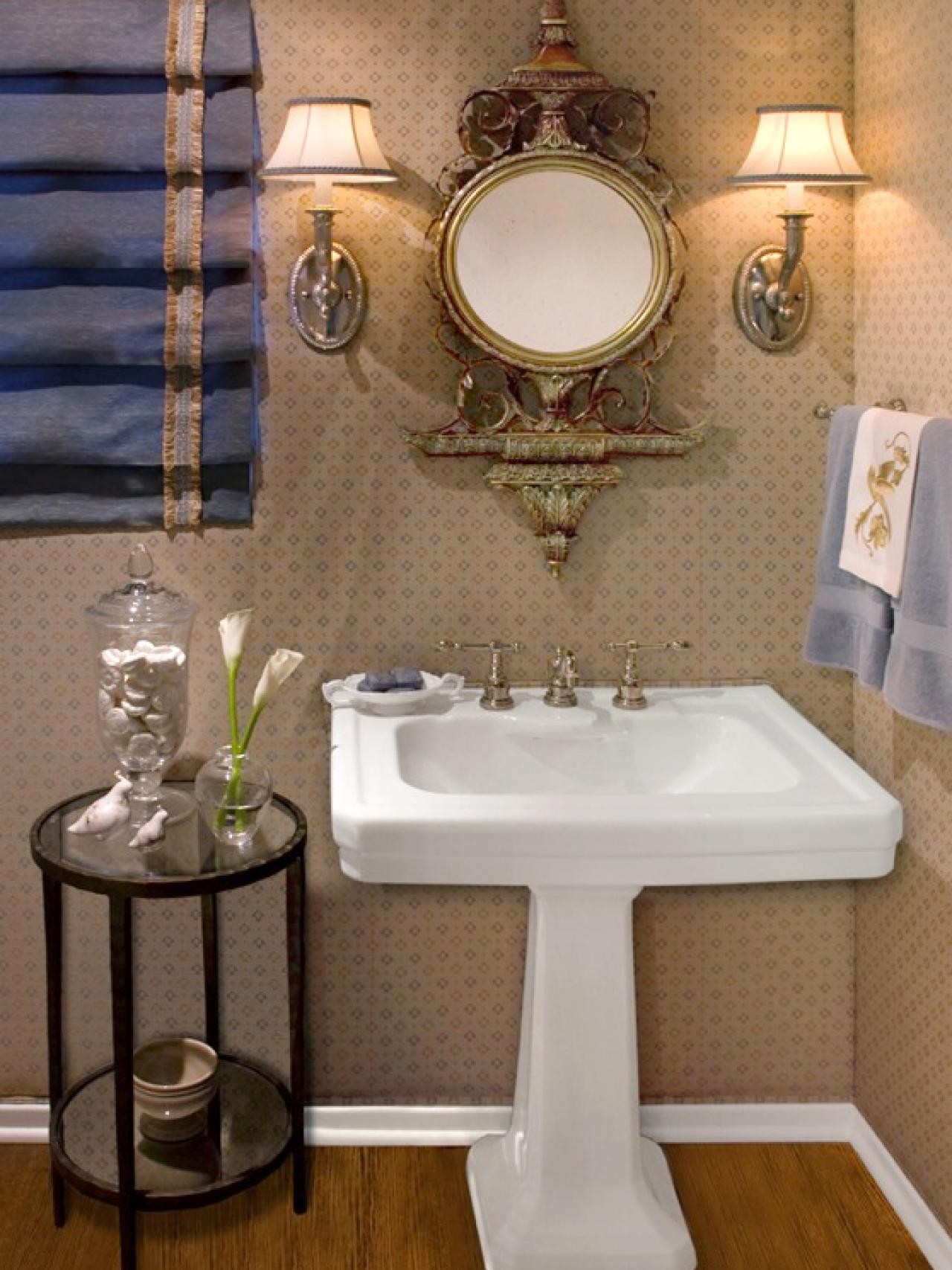 Elegant powder room with stunning pedestal sink and ornate - Small powder room sink ...