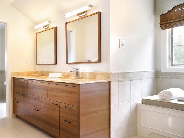 White Bathroom With Walnut Double Vanity and Honey Onyx Countertop