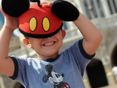 Child Wears Mickey Mouse Ears