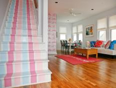 Pastel-Striped Pink and Blue Stairway and Adjoining Living Room