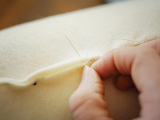 Use coordinating all-purpose thread and a needle to sew closed using a whip stitch.