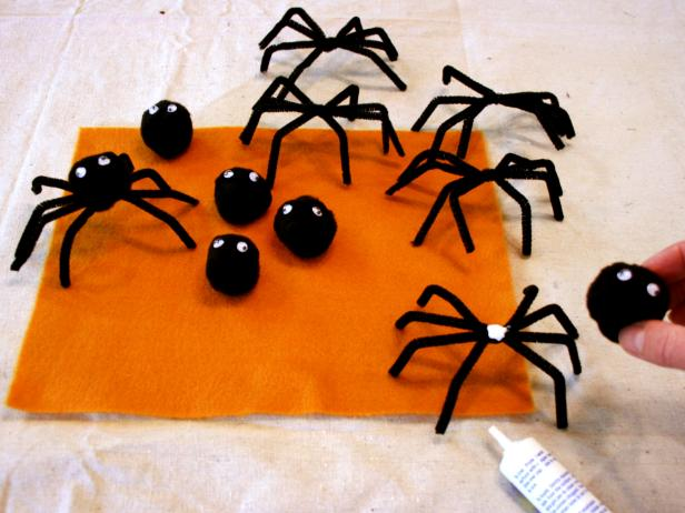 Gluing Spider Heads Onto Bodies For Halloween Napkin Rings
