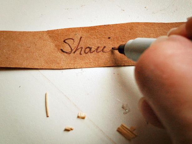 Write guest's name on card using a fine-tipped permanent marker.
