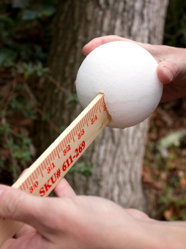 Attaching Foam Ball To Yardstick For DIY Halloween Ghost