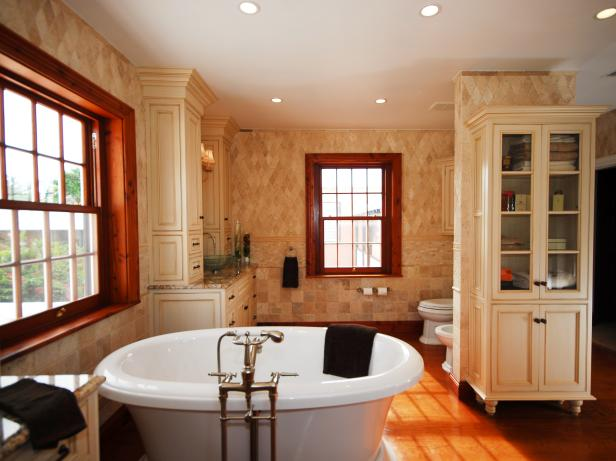 Neutral Transitional Bathroom With Freestanding Round Soaking Tub