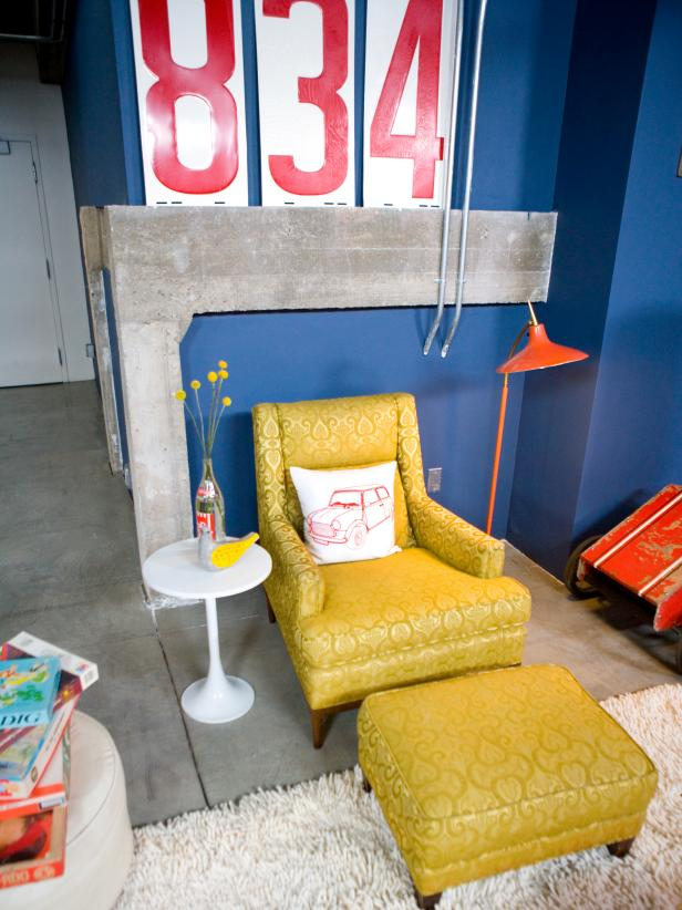 Blue Living Room With Yellow Chair and Ottoman