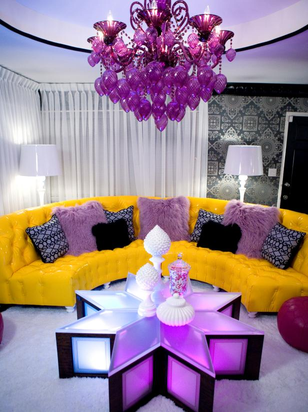 Eclectic Living Room With Curved Yellow Sofa and Purple Chandelier