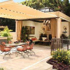 Outdoor Dining Area with Stylish Fabric Pergola and Adjacent Living Space