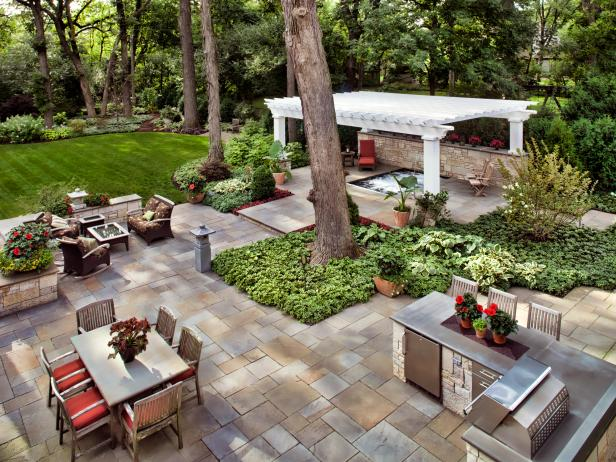 Stone Tile Patio With Seating Areas and Hot Tub